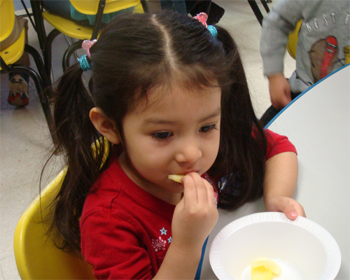 Photo: Girl Eating A Snack.